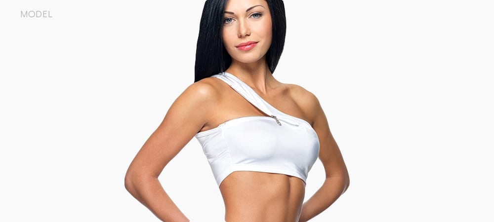 Female Fitness Model With White Sports Bra and Black Hair