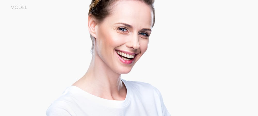 Female Model In White T-shirt Smiling and Squinting