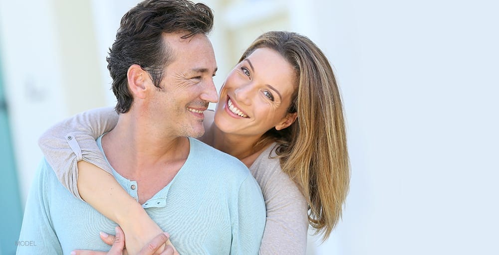 Caucasian Couple Embracing and Smiling