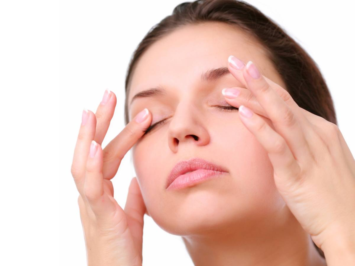 Close Up of Model's Face Covering Eyelids With Index Fingers