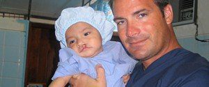 Dr. Beck Holding Lip Cleft Baby Patient