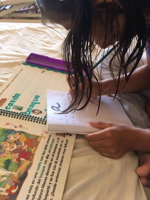 Child Practicing Letter Writing