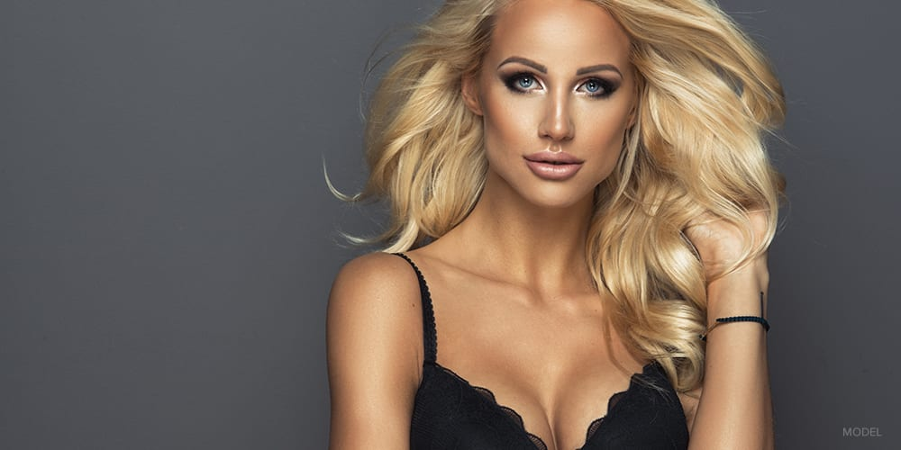 Blond Woman With Defined Facial Features in Black Bra