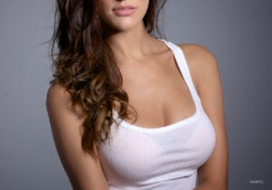 Female With Large Sized Breasts in White Tank