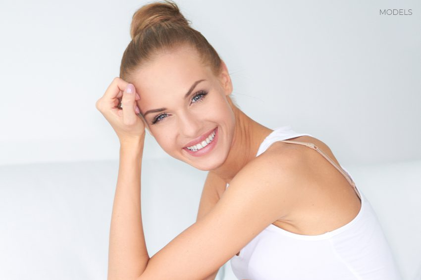 Female Model Smiling and Leaning on Hand