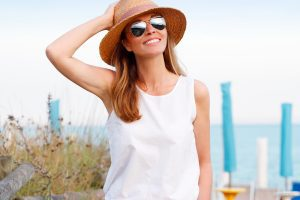 Woman in a Sunhat and Sunglasses