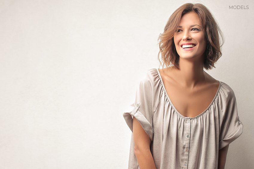 Adult Woman Smiling Away from Camera
