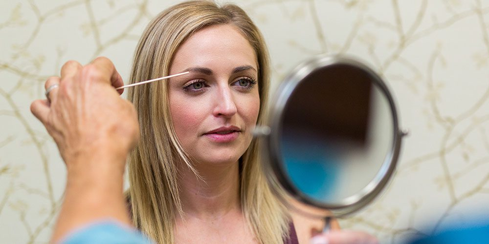 Female Patient Having Her Eyebrows Examined