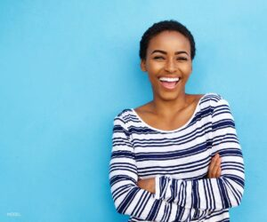 Young Black Woman With Beautiful Smile on Blue Background
