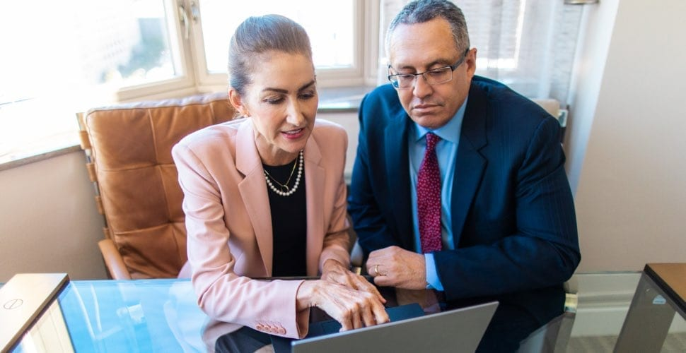 Dr. Furnas and Dr. Canales on the computer