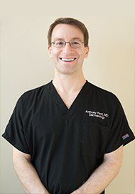 Dr. Perri in Black Scrubs