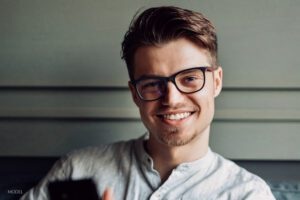 Young Male With Glasses Smiling