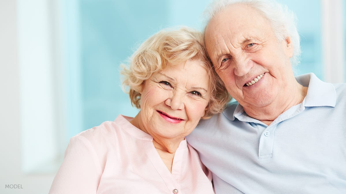 Elderly Couple Embracing and Smiling