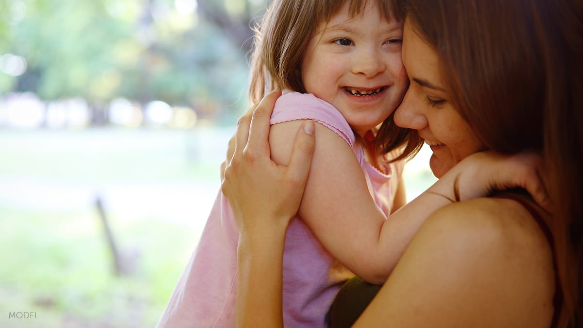 Mother Embracing Special Needs Child