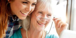 Young Woman Looking Over Grandma's Shoulder