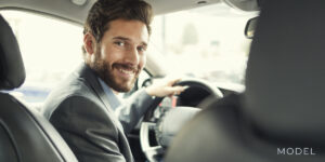 Smiling Young Business Man Driving to Car