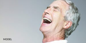 Older Male with Dental Implants Opening Mouth Broadly