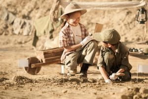 children studying archaology