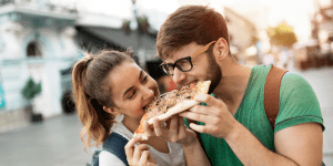 two people eating pizza