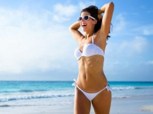 Middle Aged Woman in White Bikini and Sunglasses