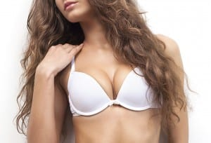 Model with Long Curly Brown Hair in White Bra