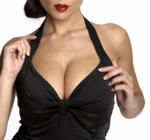 Breasts in Black Low Cut Blouse Close Up