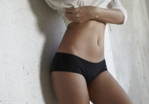 Torso of Model with Flat Stomach in Black Shorts