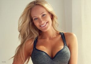 Smiling Caucasian Model in Gray Sports Bra