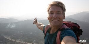 Middle Aged Man Hiking and Taking a Selfie