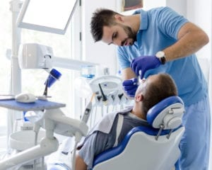 Patient Undergoing Tooth Extraction in Dental Office