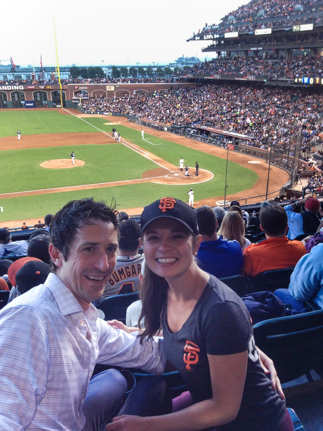 dr. Rittenbach with husband at a giants baseball game