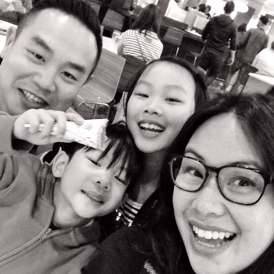 dr. Michael chan with his family in black and white