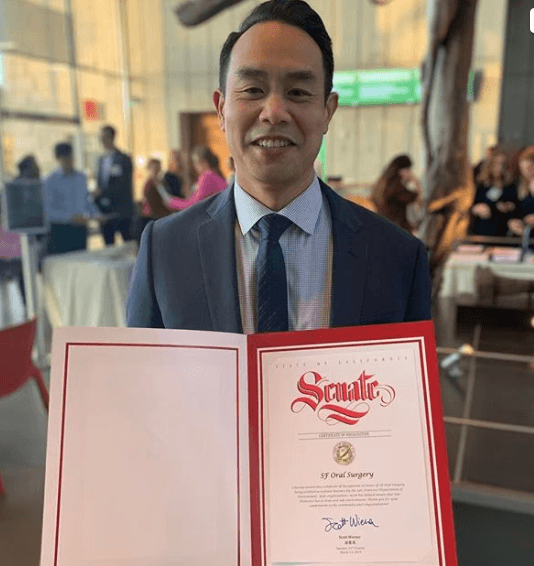 Dr. Chan with Senate Certificate