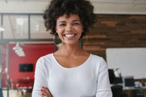 Woman Crossing her Arms with a Big Smile