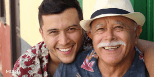 Young Man With Arms Around His Grandfather
