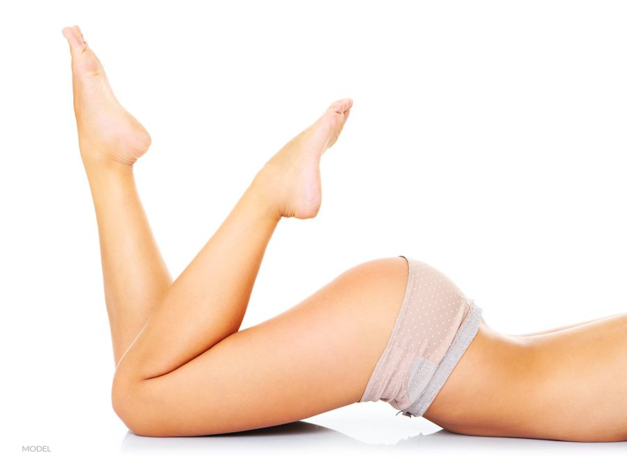 Lower Body Shot of Woman Laying Down with Legs Up