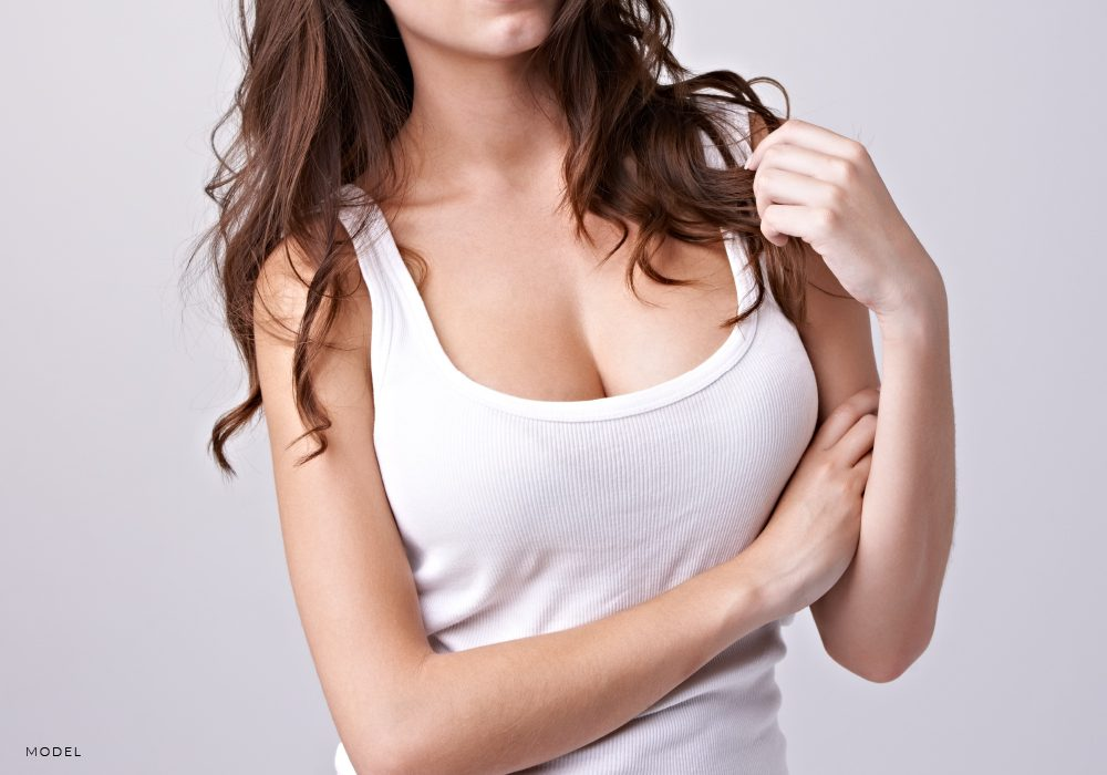 Mid-Body Shot of Woman in White Tank