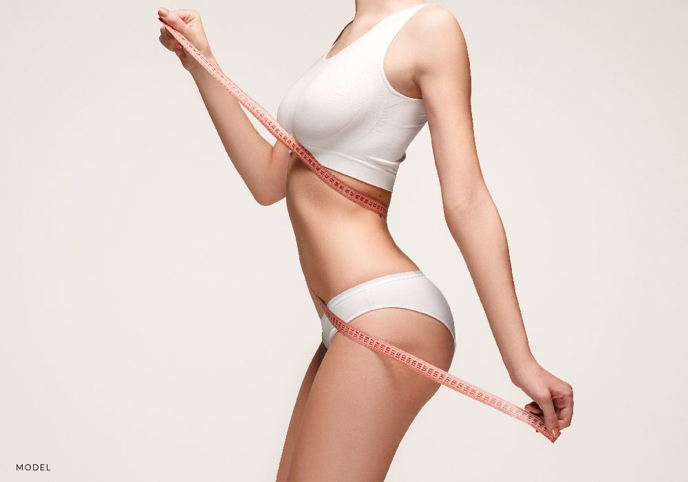 Female Torso Wrapped in Pink Measuring Tape