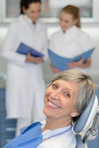 Senior woman patient at dentist surgery smiling copy