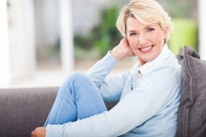 Blond Mature Female Reclining on Couch