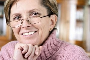 Mature Female with Glasses and Pink Sweater