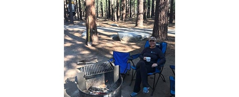 Dr. Beck Sitting at a Campsite