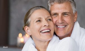 Couple in white robes smiling